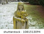 Statue Covered In Snow On A...