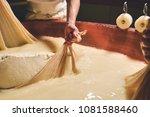 a cheesemaker prepares a form... | Shutterstock . vector #1081588460