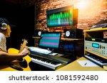 asian male musician recording... | Shutterstock . vector #1081592480