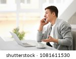 young man talking on phone... | Shutterstock . vector #1081611530