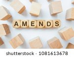 amends word on wooden cubes | Shutterstock . vector #1081613678