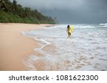 girl surfer holds a board and... | Shutterstock . vector #1081622300