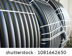 pvc pipes stacked in warehouse | Shutterstock . vector #1081662650