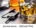 car keys and glass of alcohol... | Shutterstock . vector #1081667546
