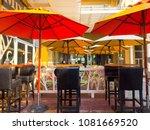 Red Umbrellas Of A Coffee Shop...