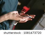 a young woman's hands holding... | Shutterstock . vector #1081673720