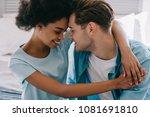 young woman embracing boyfriend ... | Shutterstock . vector #1081691810