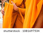 yellow robe of buddhist monks ... | Shutterstock . vector #1081697534