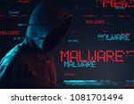 Small photo of Malware concept with faceless hooded male person, low key red and blue lit image and digital glitch effect