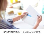 young woman putting letter into ... | Shutterstock . vector #1081732496