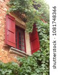 wooden window in the stone... | Shutterstock . vector #1081748366