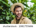 Stock photo handsome young man with parrot on shoulder 1081755686