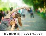 Small photo of Men and women exercising, aerobics, aerobics in the garden