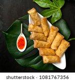 spring rolls on the black board ... | Shutterstock . vector #1081767356