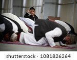 muslims pray during the... | Shutterstock . vector #1081826264