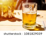 glass of cold beer outside on a ... | Shutterstock . vector #1081829039