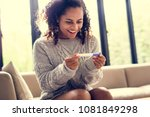 woman with a pregnancy test | Shutterstock . vector #1081849298
