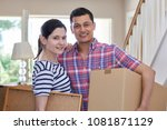 portrait of couple carrying... | Shutterstock . vector #1081871129