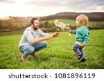 a father with his toddler son... | Shutterstock . vector #1081896119
