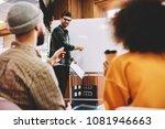 successful male coach... | Shutterstock . vector #1081946663