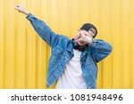 young man throws dab on the... | Shutterstock . vector #1081948496