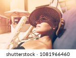 attractive woman tanning on the ...   Shutterstock . vector #1081966460