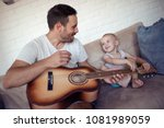 father playing on guitar and... | Shutterstock . vector #1081989059