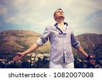 carefree man enjoying in... | Shutterstock . vector #1082007008