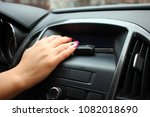 the woman's hand reaches out to ... | Shutterstock . vector #1082018690
