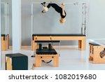 female pilates instructor in... | Shutterstock . vector #1082019680