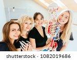 selfie portrait of four happy... | Shutterstock . vector #1082019686