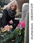 Woman Puts A Teddy Bear On The...