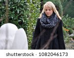 a woman in mourning over the... | Shutterstock . vector #1082046173