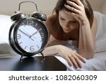 woman can not fall asleep late... | Shutterstock . vector #1082060309