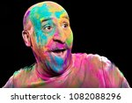 happy man covered in brightly... | Shutterstock . vector #1082088296