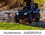 couple enjoys riding an atv on... | Shutterstock . vector #1082092916