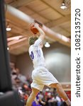 Small photo of Basketball player jumping high for a rebound