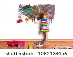 cute little child painting  on ... | Shutterstock . vector #1082138456