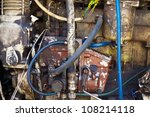 battered old farm tractor engine - stock photo