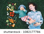 happy mother and little baby... | Shutterstock . vector #1082177786