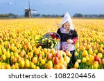 child in tulip flower field... | Shutterstock . vector #1082204456