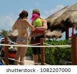 couple with child in a tropical ... | Shutterstock . vector #1082207000