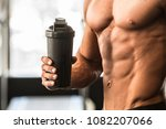 man with perfect body holds...   Shutterstock . vector #1082207066