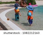 two boys are prepared to swim... | Shutterstock . vector #1082212163