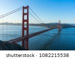 golden gate bridge at sunrise... | Shutterstock . vector #1082215538
