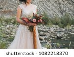 bride holding colorful elegant... | Shutterstock . vector #1082218370