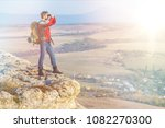 active hiker enjoying the view | Shutterstock . vector #1082270300
