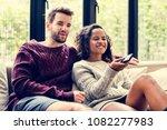 couple watching a tv show... | Shutterstock . vector #1082277983