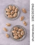 pecan nuts in plate and... | Shutterstock . vector #1082303960
