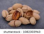 close up pecan nuts on dark... | Shutterstock . vector #1082303963